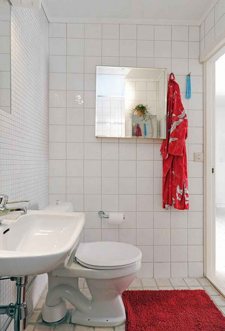 interesting-small-bathroom-design-with-toilet-and-washing-stand-plus-red-bath-mat-on-white-tiles-flooring-as-well-as-mirrored-recessed-medicine-cabinets-744x1095