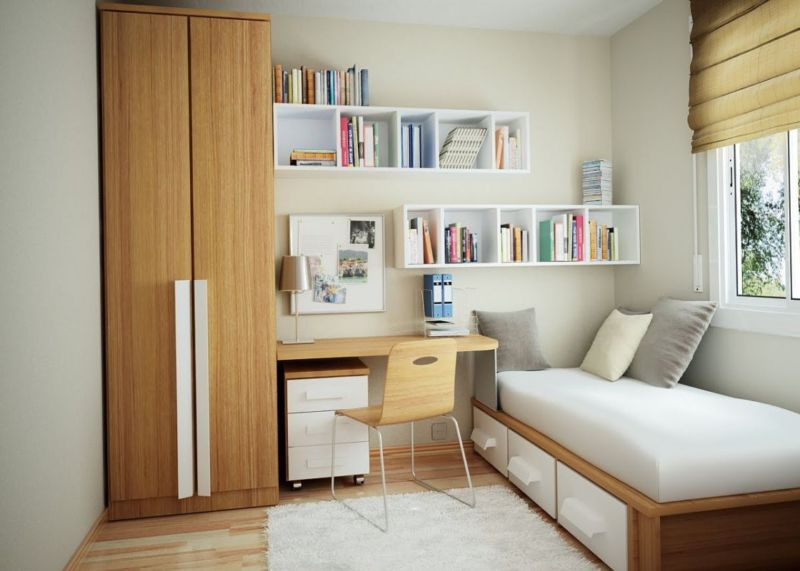 minimalist-tiny-apartment-design-with-brown-wooden-cupboard-near-desk-and-white-wooden-floating-bookshelf-attached-to-the-white-wall-also-brown-wooden-single-bed-frame-fitted-white-wooden-3-sliding-dr