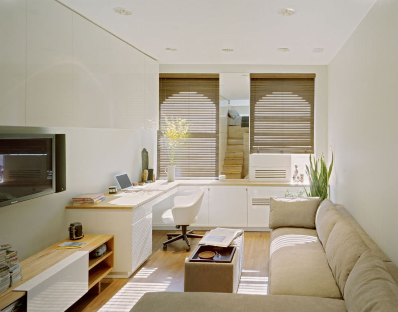 modern-elegant-small-apartments-design-that-has-white-modern-concrete-wall-can-be-decor-with-modern-brown-sofas-that-can-add-the-beauty-inside