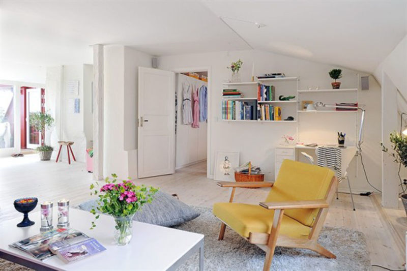 terrific-interior-design-small-apartments-in-modern-scheme-with-white-nuance-smart-decorations-and-bookshelves-on-white-walls-space-also-flower-on-vase-and-coffee-table