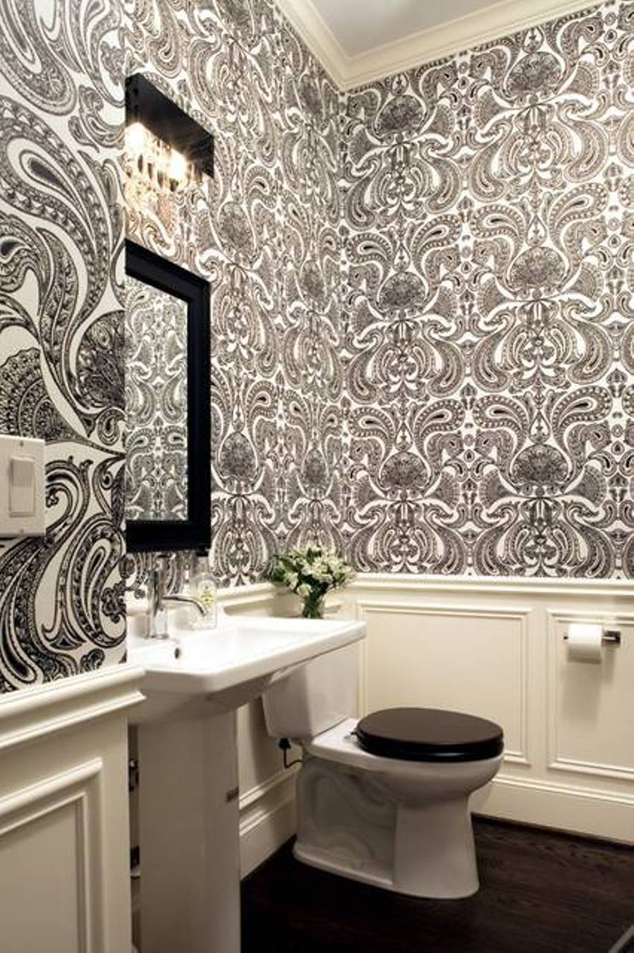 wainscoting-and-wallpaper-bathroom-bathroom-with-wallpaper-and-wainscoting-and-pedestal-sink-and-mirror-and-padded-black-elongated-toilet-seat