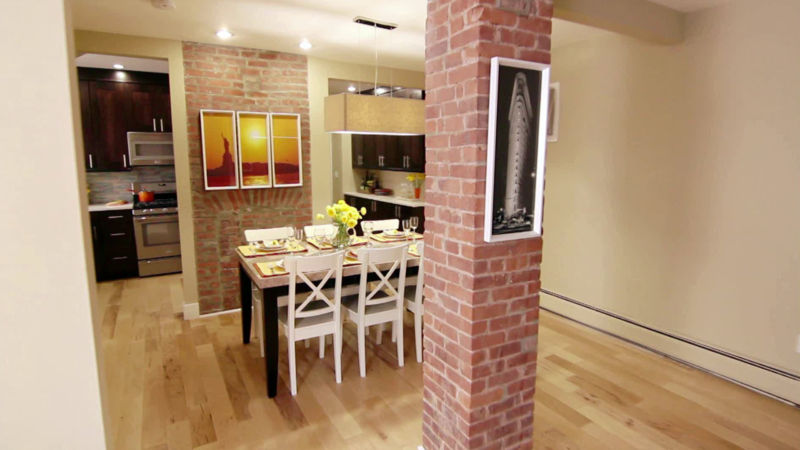 A tiny brick kitchen that has been renovated.
