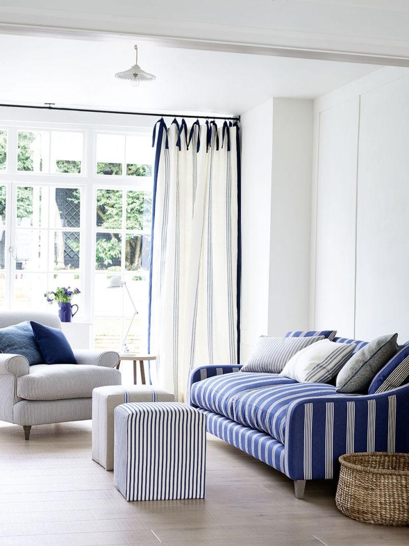 3-ian-mankin-blue-living-room-sofa-in-oxford-stripe-navy-armchair-in-ticking-navy-curtains-in-grain-stripe-indigo-lifestyle-portrait