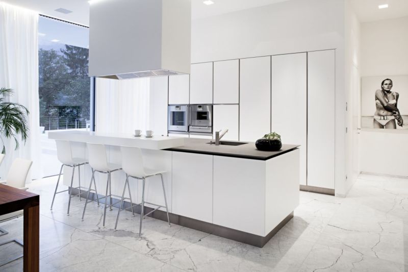 modern-white-kitchen-with-marble-floor-and-large-kitchen-island