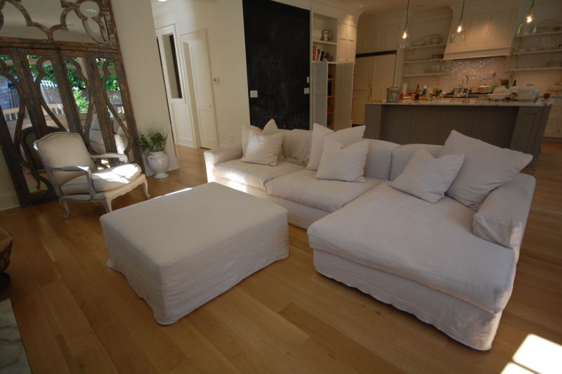 furniture-interior-decoration-classic-white-sofas-with-pillows-and-table-combined-with-wooden-flooring-and-open-kitchen-plan-for-inspiring-living-room-design-ideas-comfortable-modern-sofa-with-soft-le