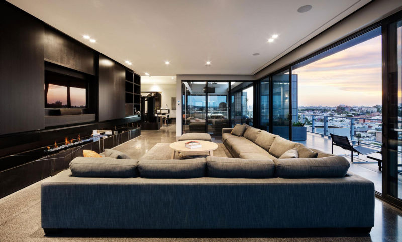 interesting-balcony-design-of-coppin-penthouse-with-windows-which-amusing-living-room-grey-sofa-pillows-and-colored-rug_interior-penthouse-glass_interior-design_online-interior-design-best-schools-des