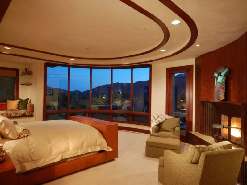 large-master-bedroom-with-built-in-day-bed-bay-window-balcony