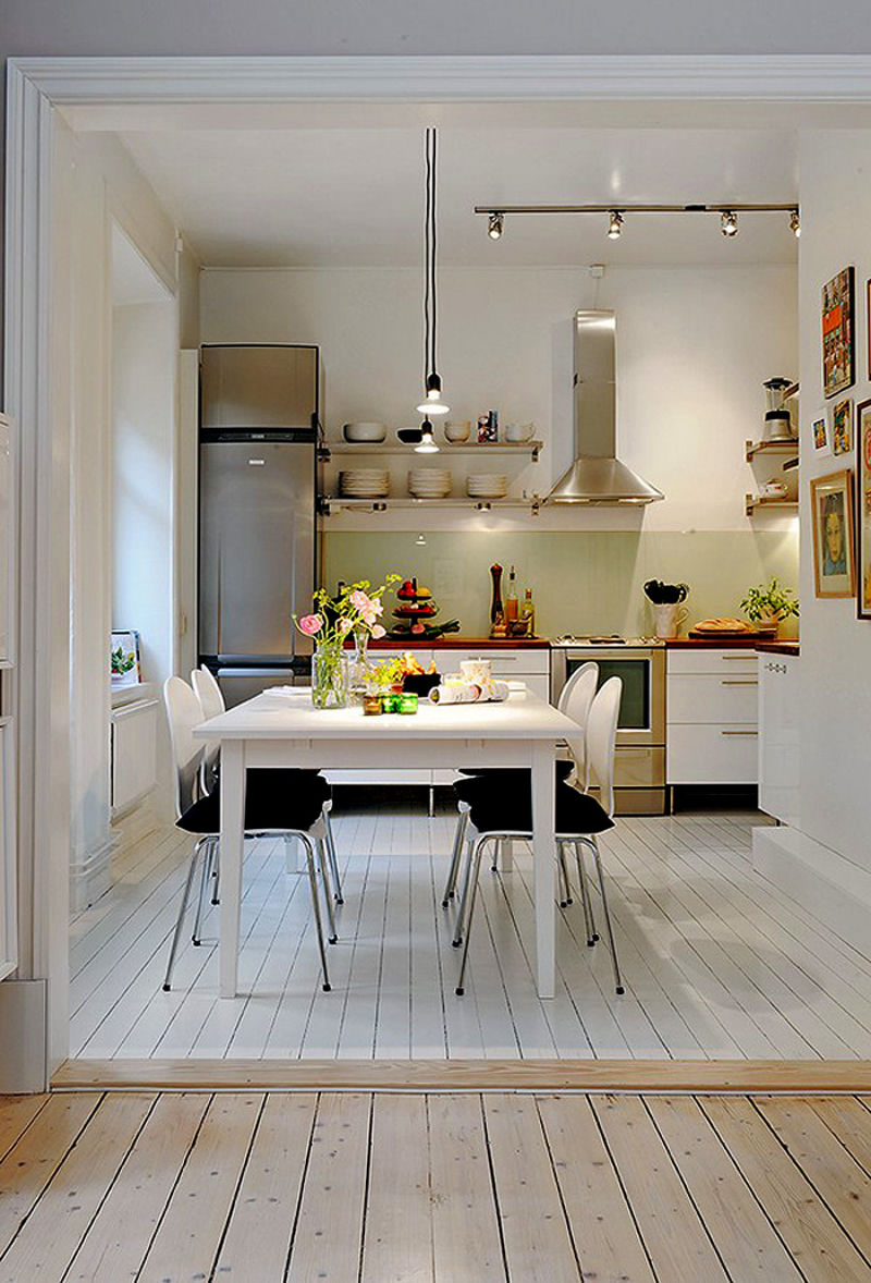 retro-white-design-for-a-small-kitchen-plus-track-lighting-also-black-dining-chair-pads-design
